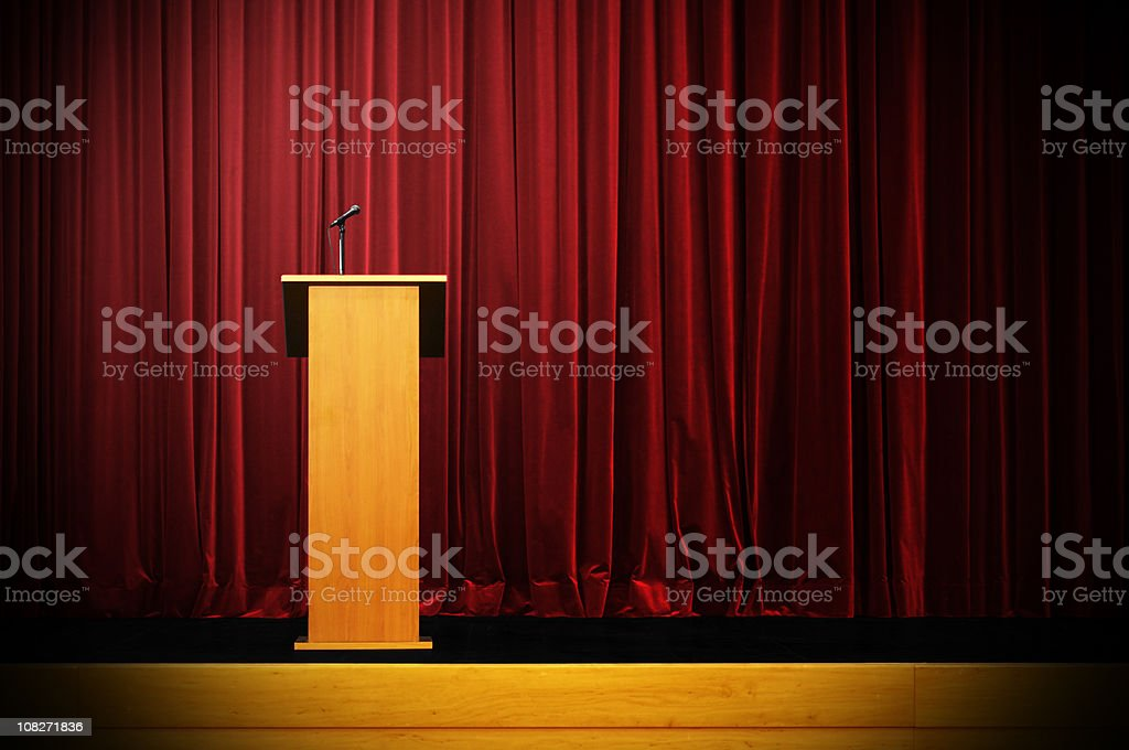 Podium on Empty Stage stock photo