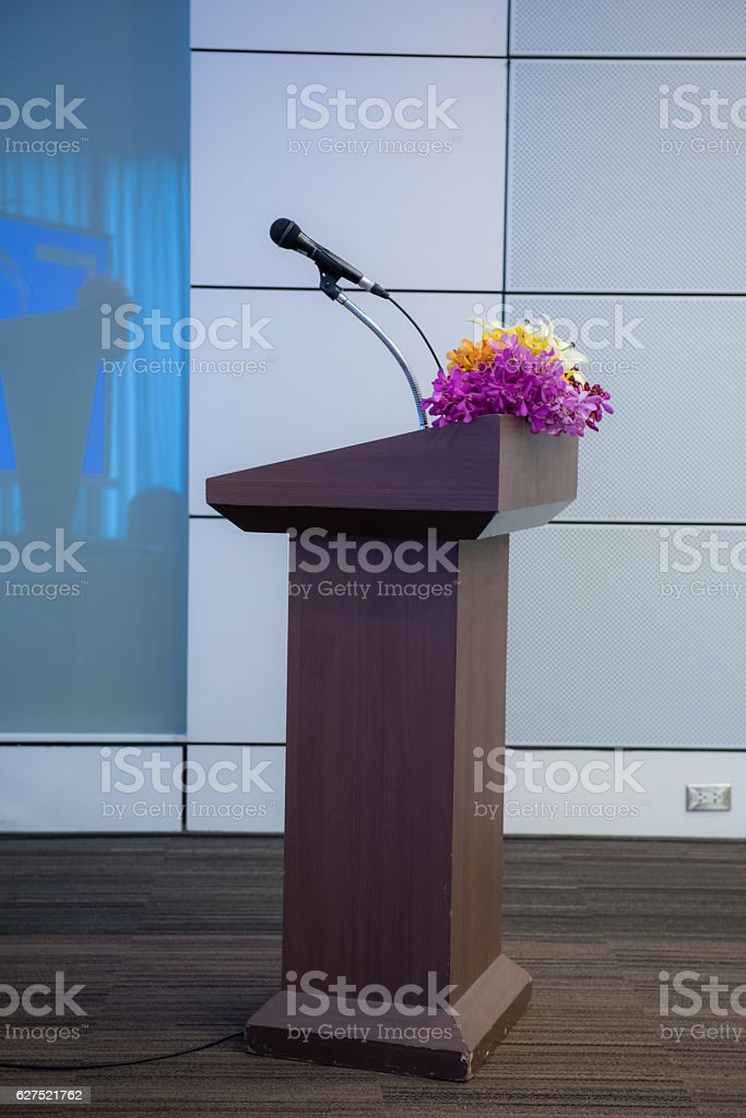 podium with microphone for speaker presentation stock photo