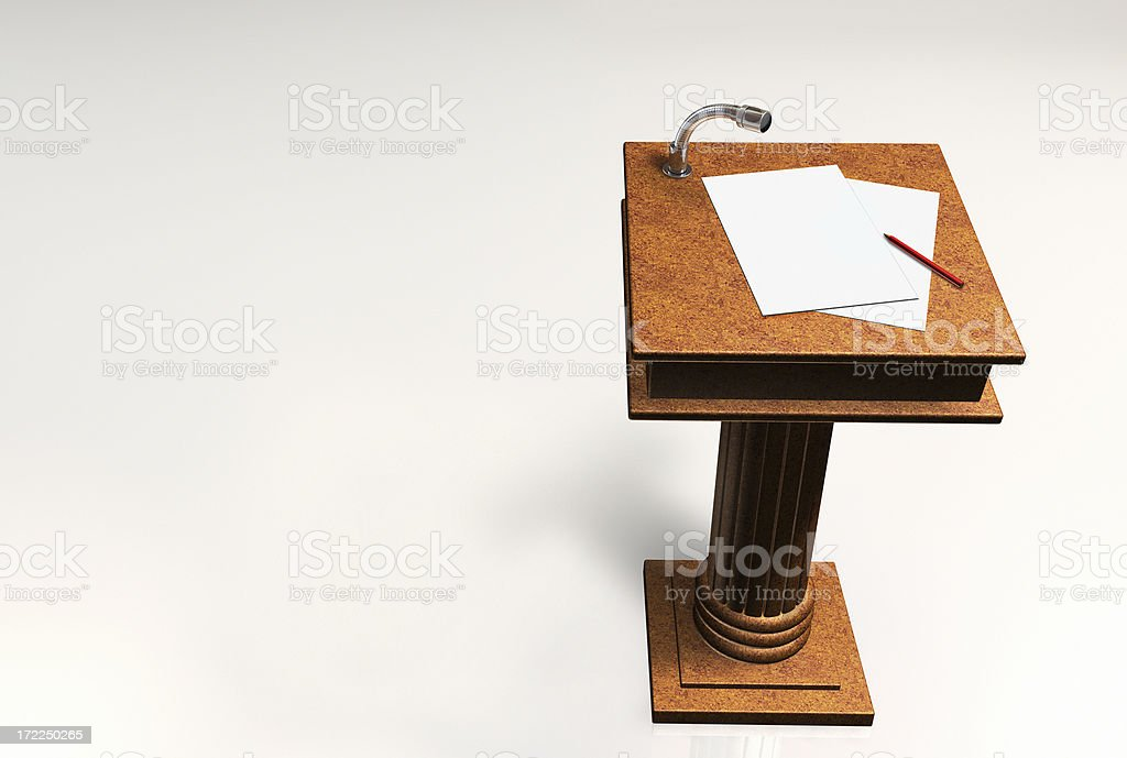 A podium with notes and a pencil on top stock photo