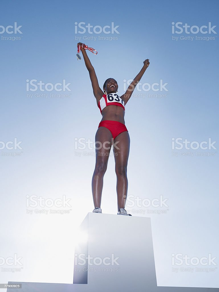Podium with winning athlete on top royalty-free stock photo