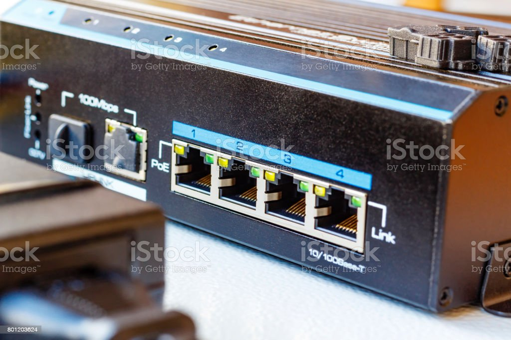 PoE ethernet switch installed on the mounting plate stock photo