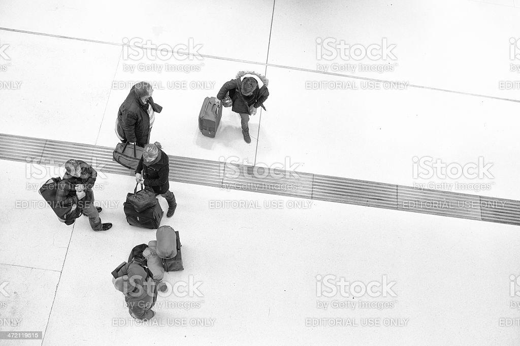 Poeple entering the railwaystation stock photo