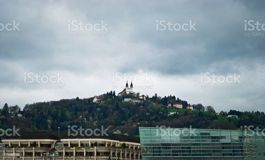Poestlingberg church in Linz on a very cloudy day stock photo