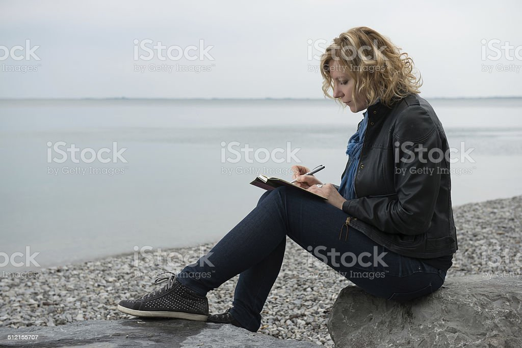 Poet by the sea stock photo