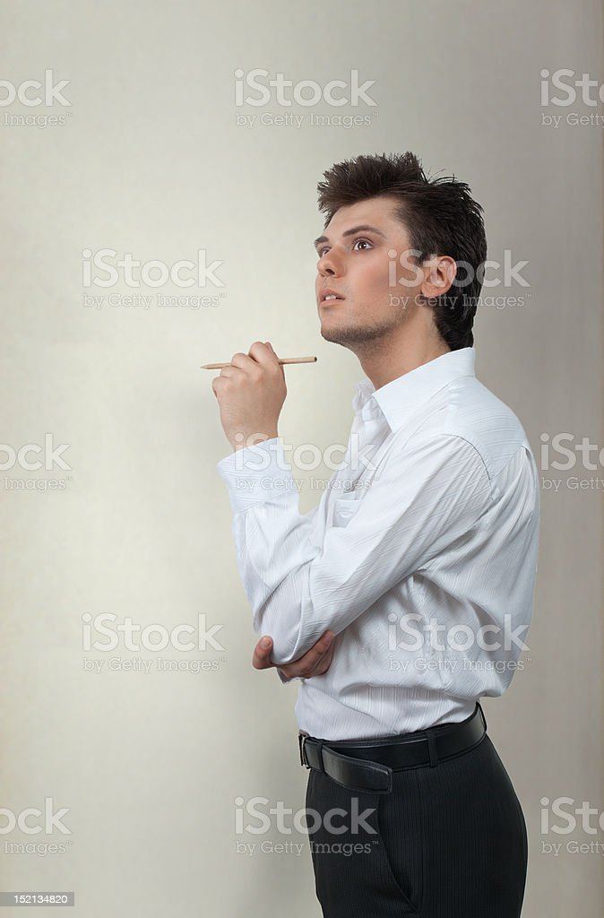 Poet with pencil thinking royalty-free stock photo