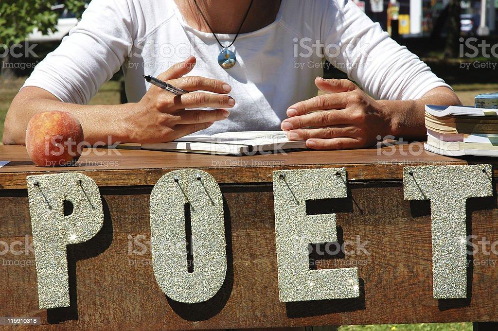 poet working stock photo