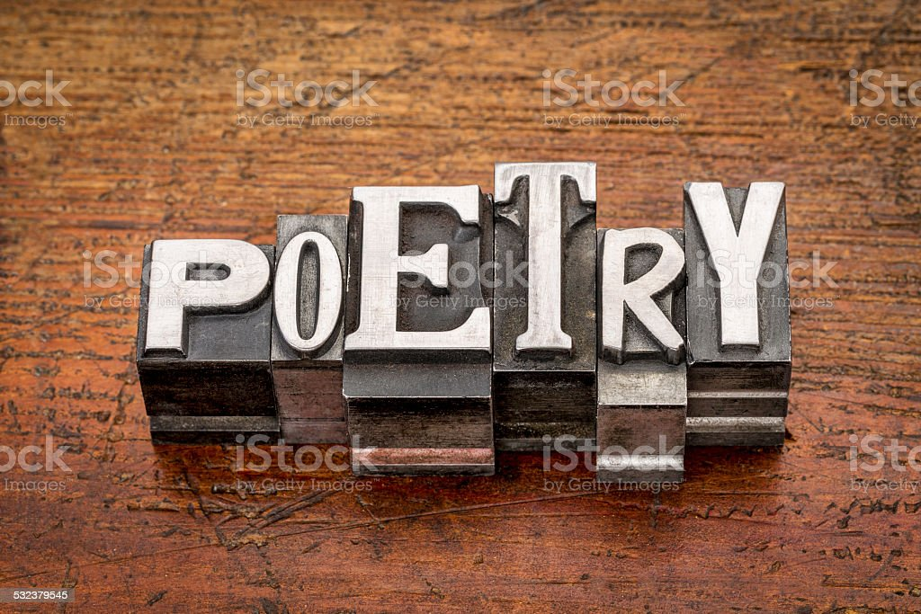 poetry word in metal type stock photo