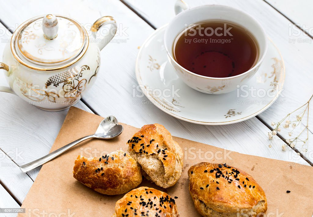 Pogaca traditional homemade Turkish savory pastries and cup of tea stock photo