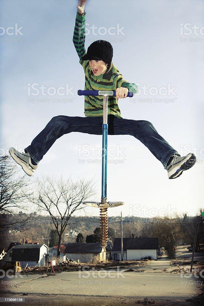 Pogo Jumping- Cross Processed stock photo