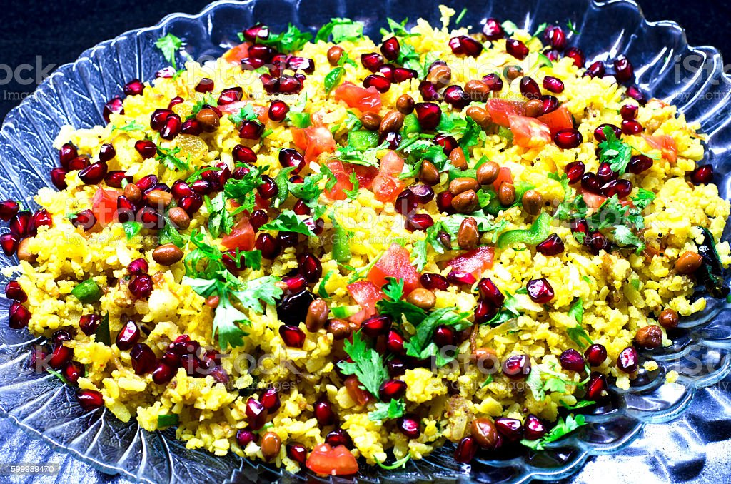 Poha, a popular Indian dish served in a tray stock photo