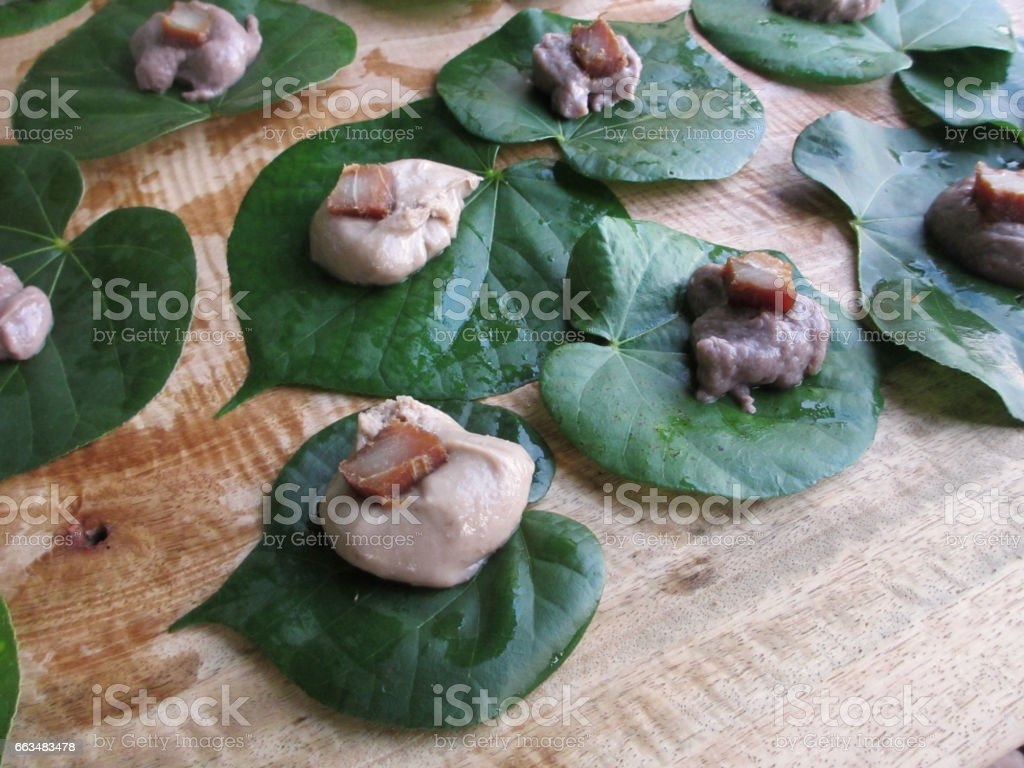 Poi on Taro Leafs top with a slice of Marin stock photo