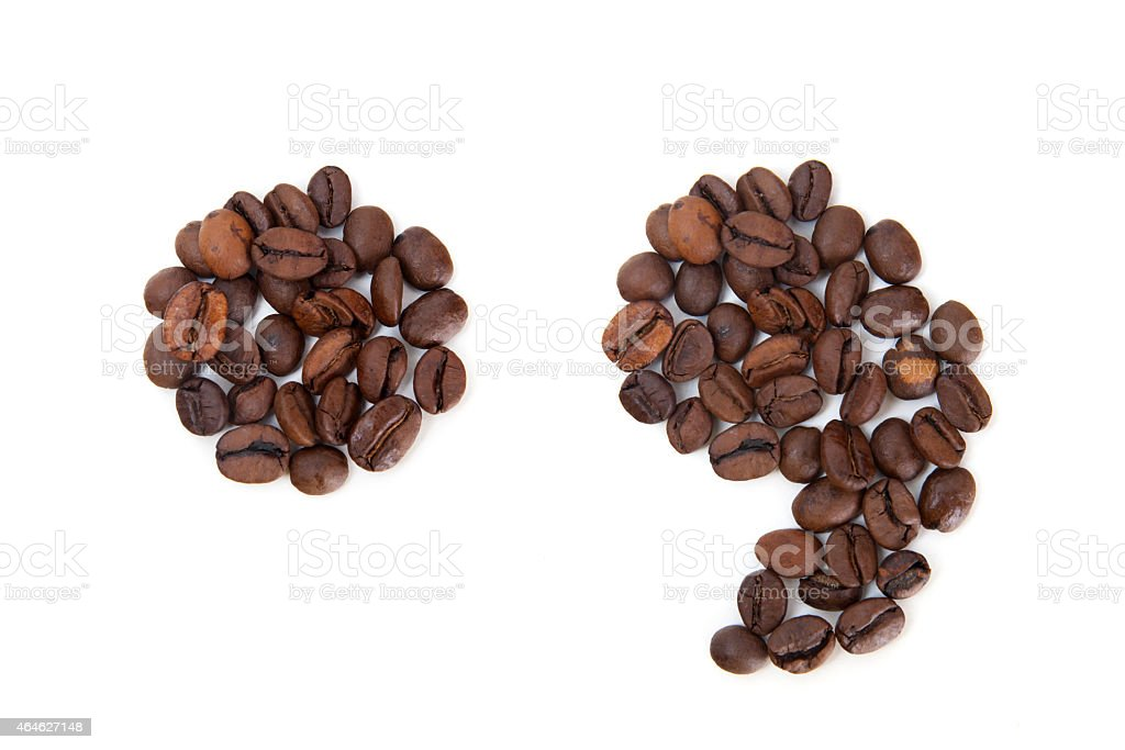 Point and comma marks made with coffee beans stock photo
