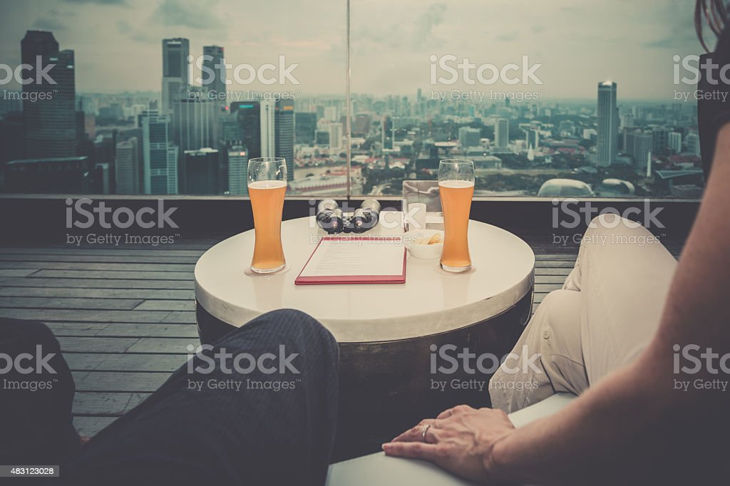 Point of View Couple Relaxing on Rooftop Deck stock photo