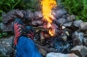 Point Of View Man Feet Close to Campfire in Summertime