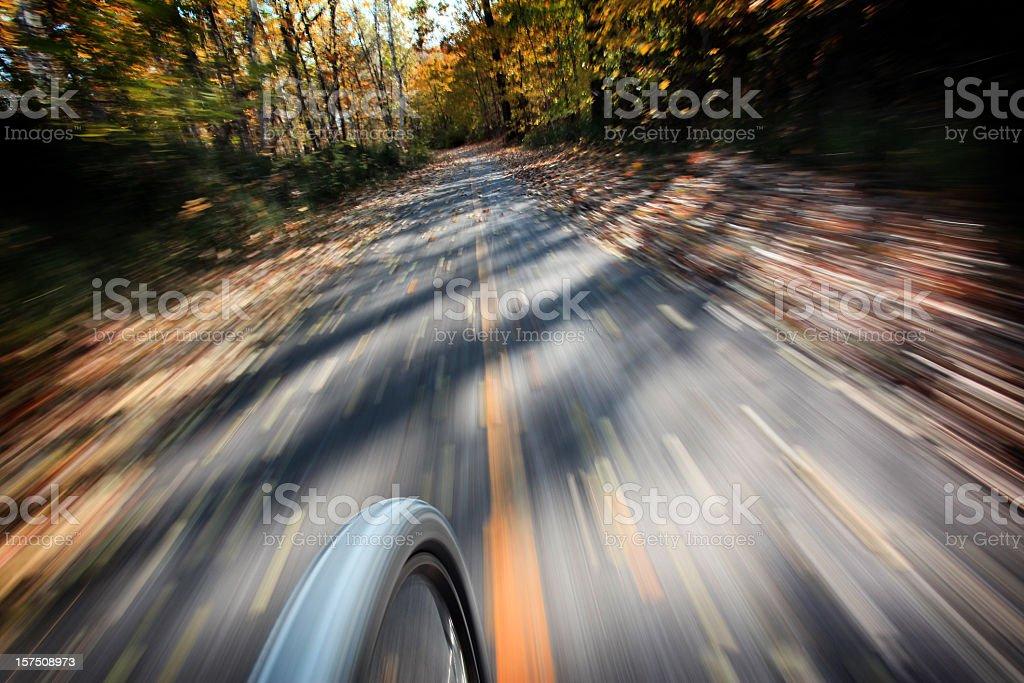 Point Of View Mountain Bike Front Wheel Speeding on Cyclepath royalty-free stock photo