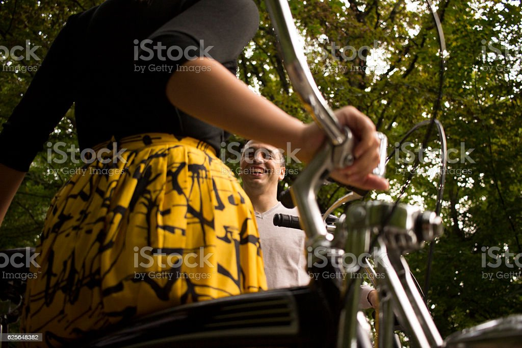 Point of view through a bicycle frame on a man stock photo