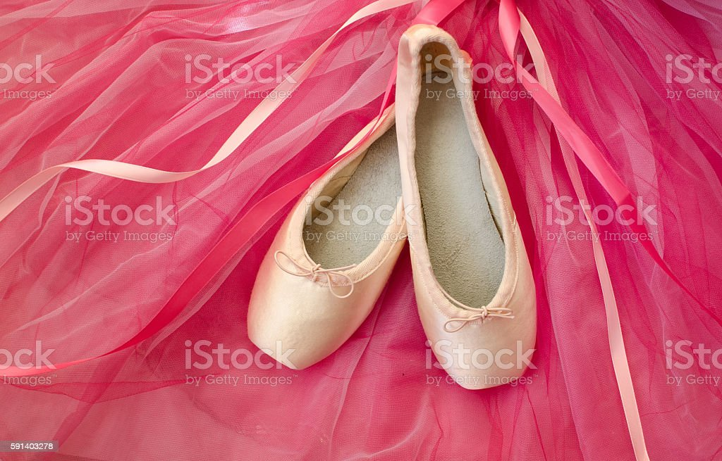 Pointe shoes and pink tutu stock photo