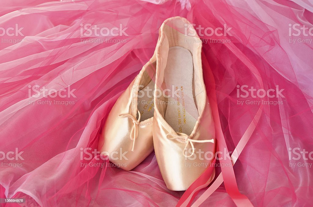 Pointe shoes on pink background stock photo