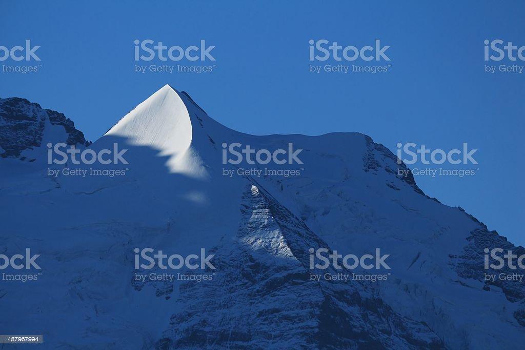 Pointed mountain Peak next to Mt Jungfrau stock photo