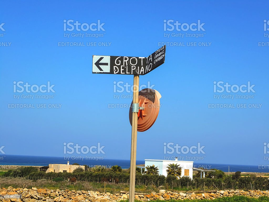 Pointer to the grotto of dolphins on  island of Favignana stock photo