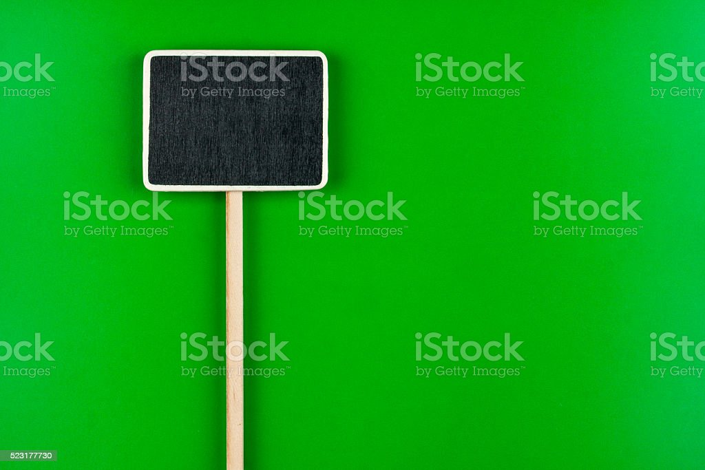 Pointer with space for your text, lies on green stock photo