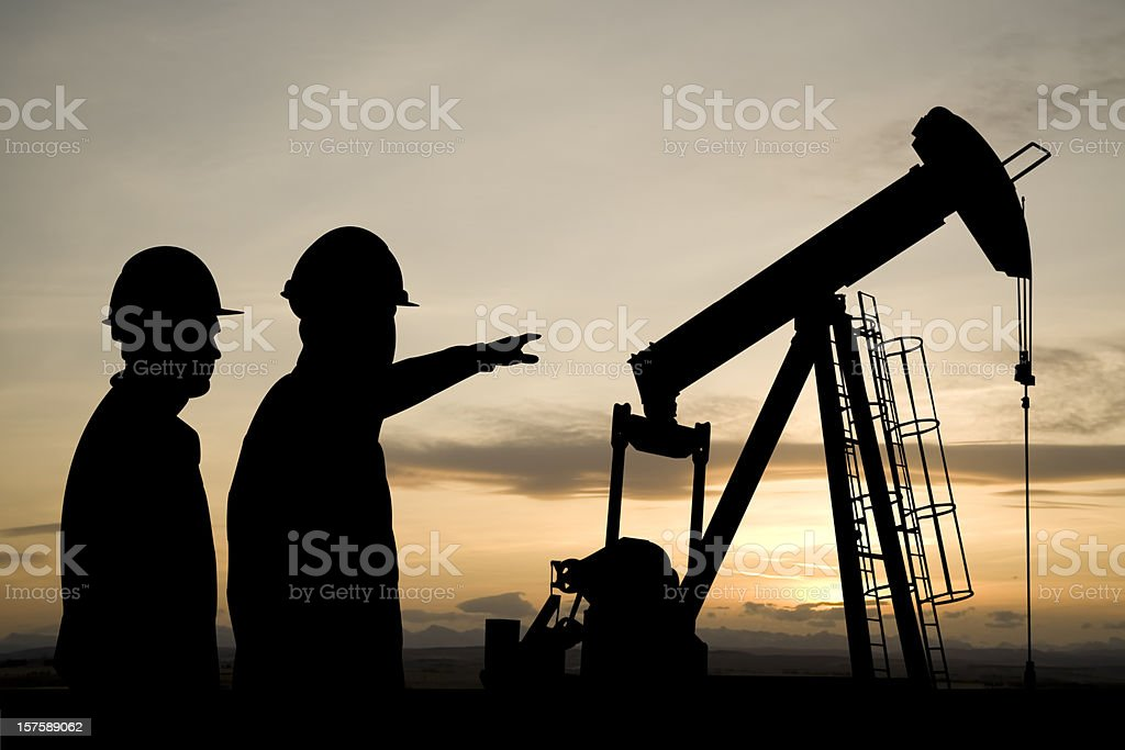 Pointing at a Pumpjack stock photo