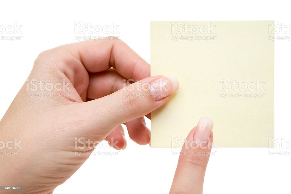 Pointing at a Yellow Note royalty-free stock photo