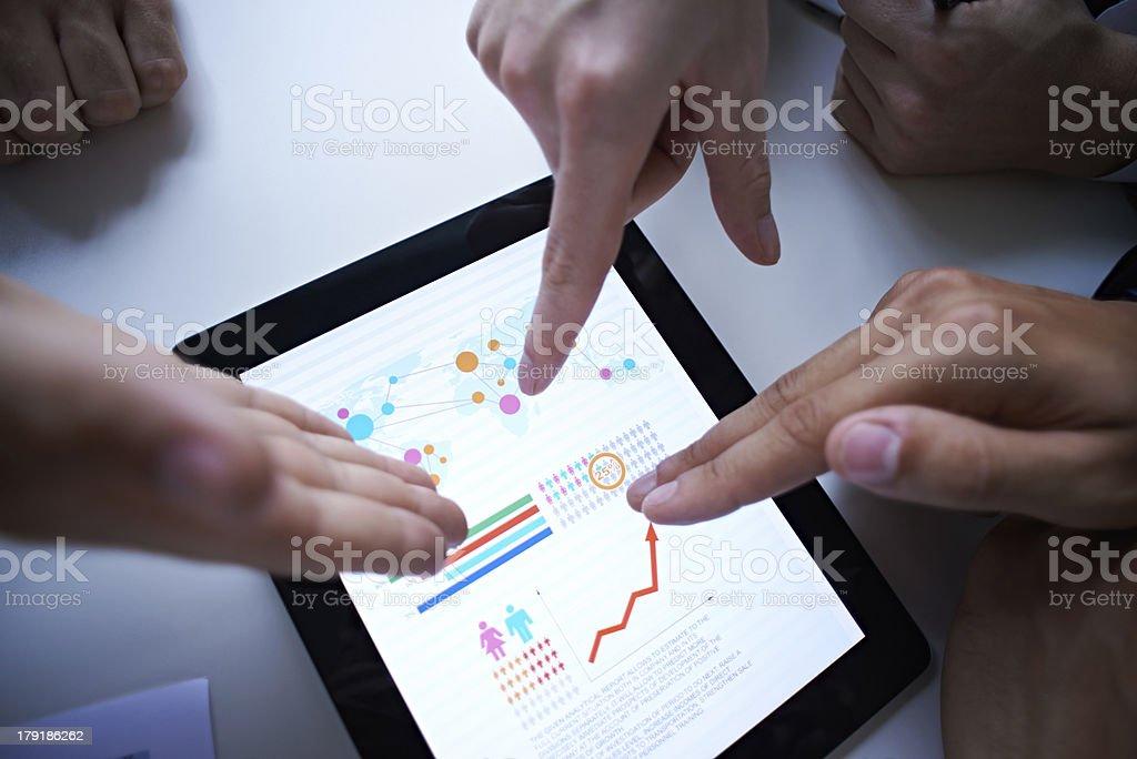 Pointing at graphs royalty-free stock photo