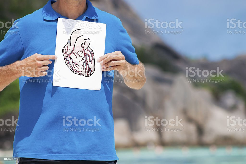 Pointing at heart stock photo