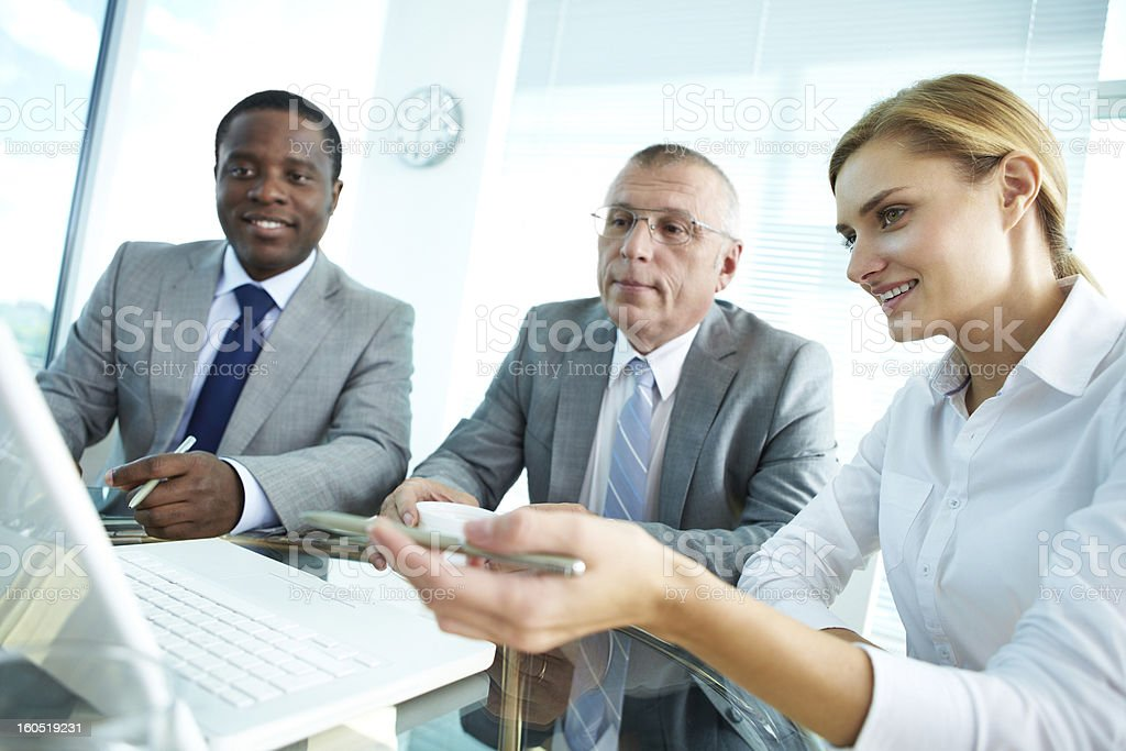 Pointing at laptop royalty-free stock photo