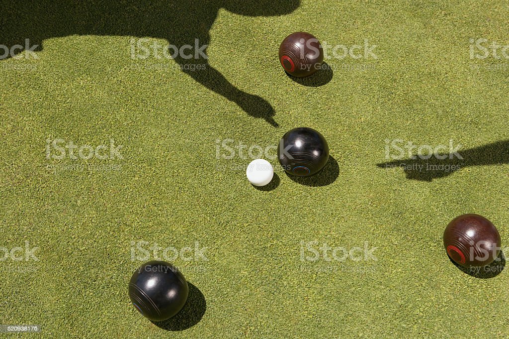 Pointing at lawn bowling stock photo