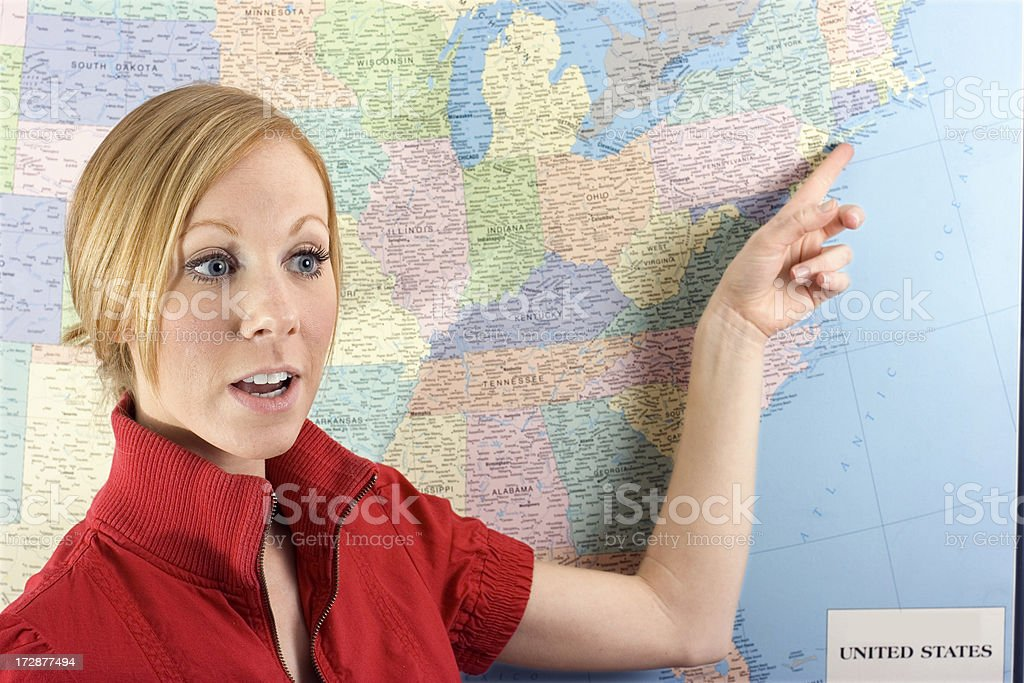 Pointing at New York City on a map royalty-free stock photo
