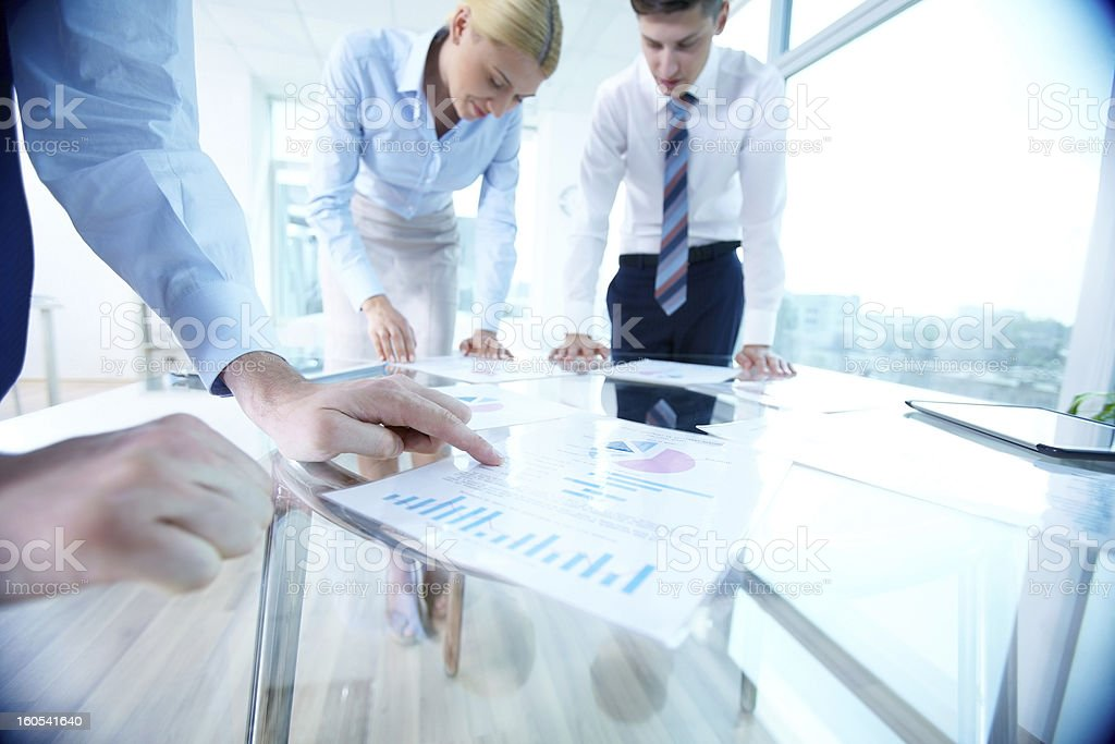 Pointing at spreadsheet royalty-free stock photo
