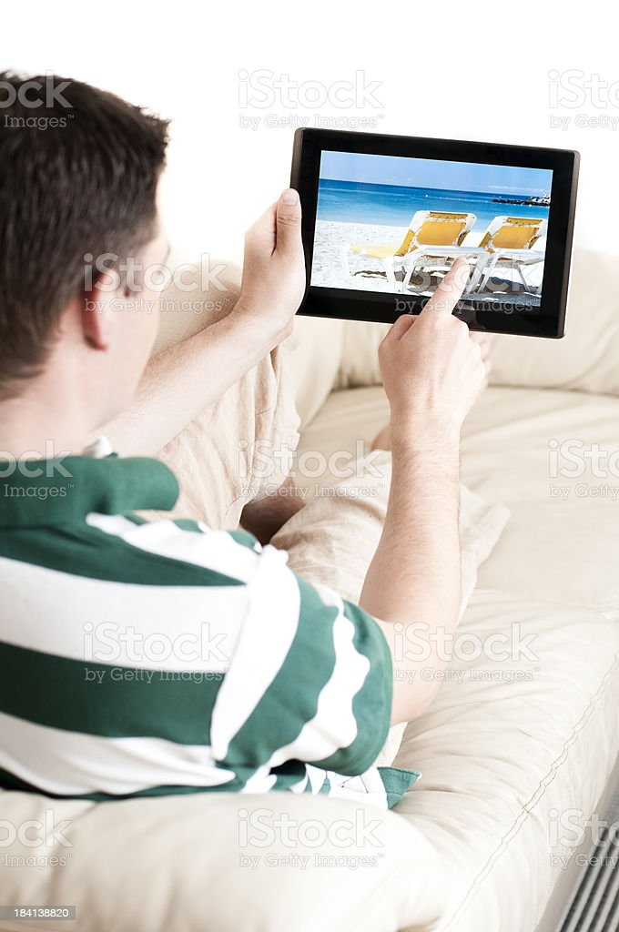 Pointing at the touch screen on a tablet computer royalty-free stock photo