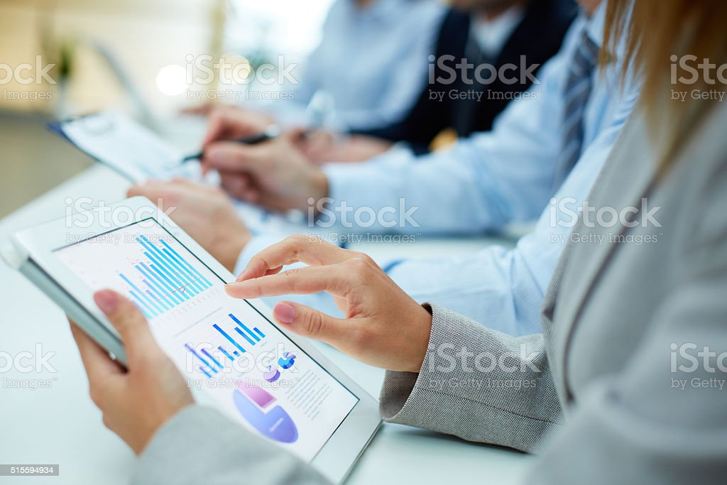 Pointing at touchscreen stock photo