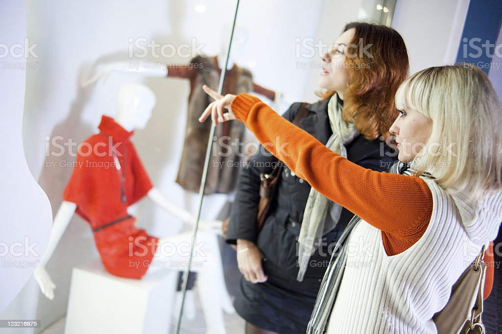 Pointing at window display stock photo