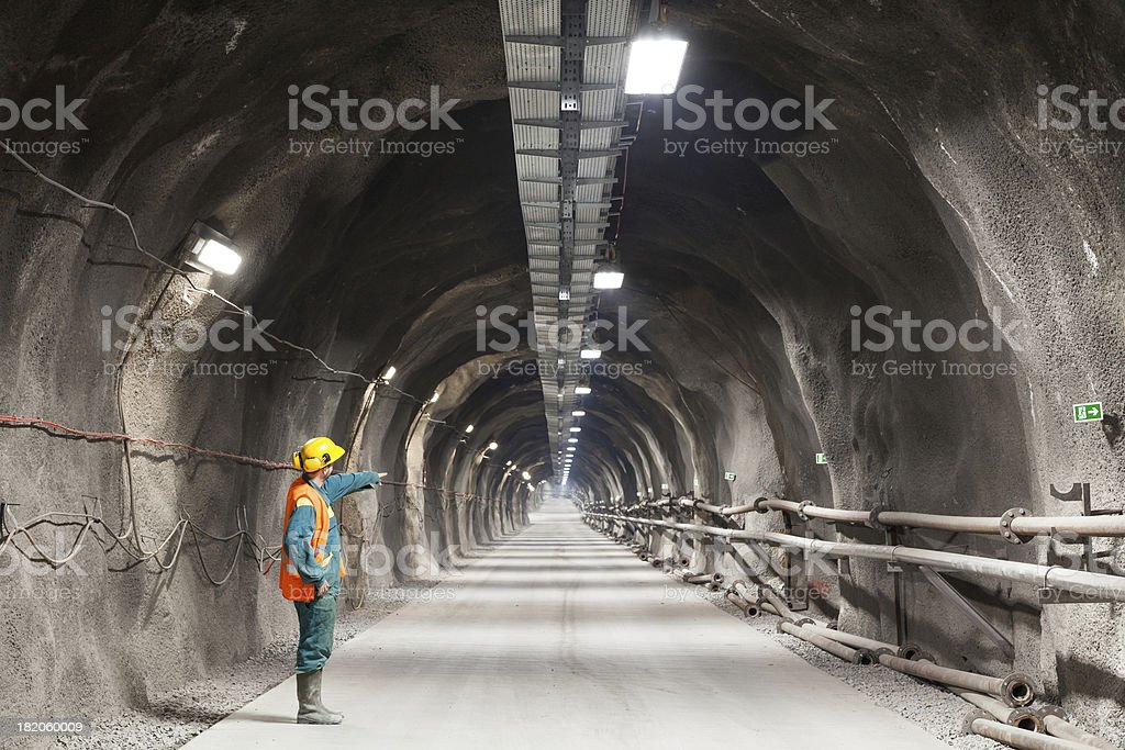 Pointing downward in a tunnel/mine stock photo