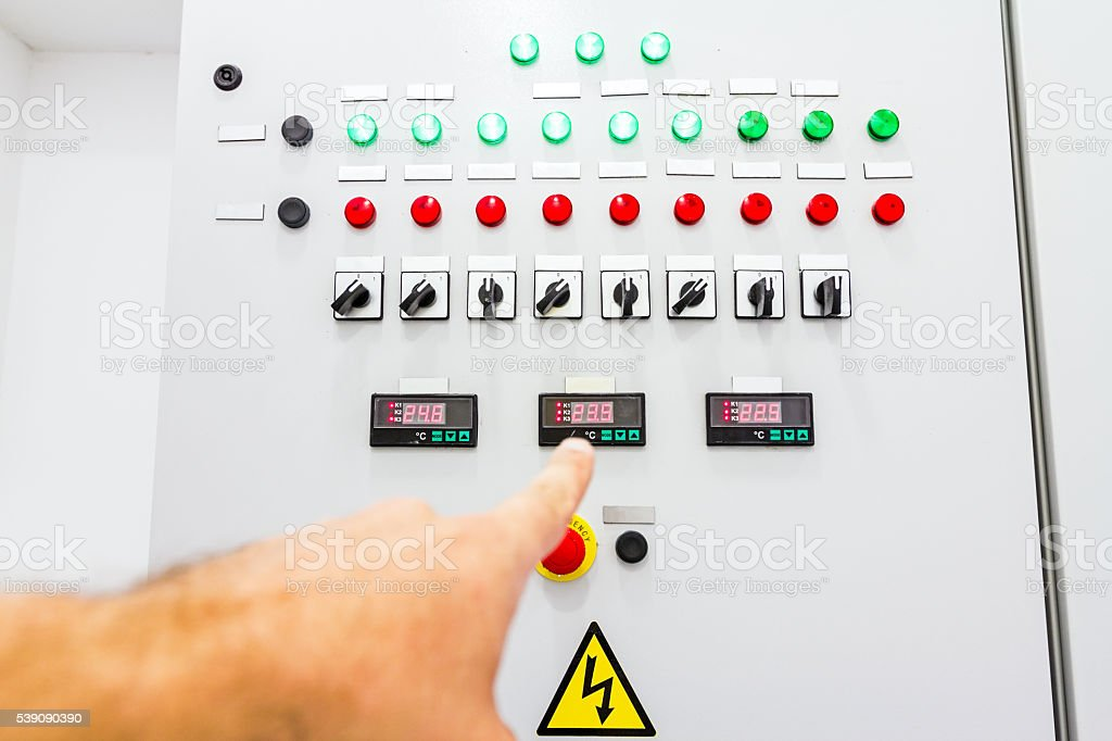 Pointing Finger on display, fuse box stock photo