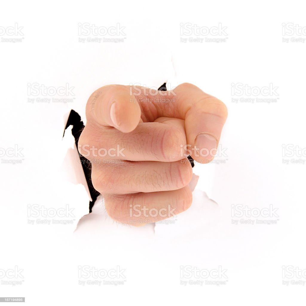 Pointing Hand Bursting Through Background stock photo