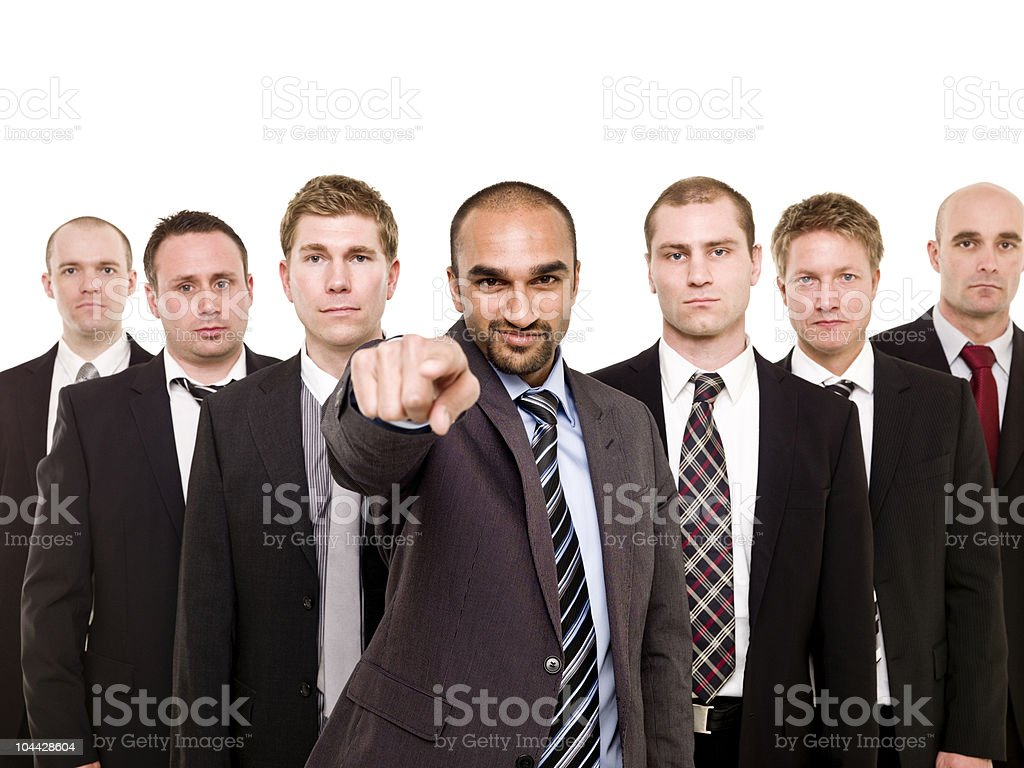 Pointing man in front of his team stock photo