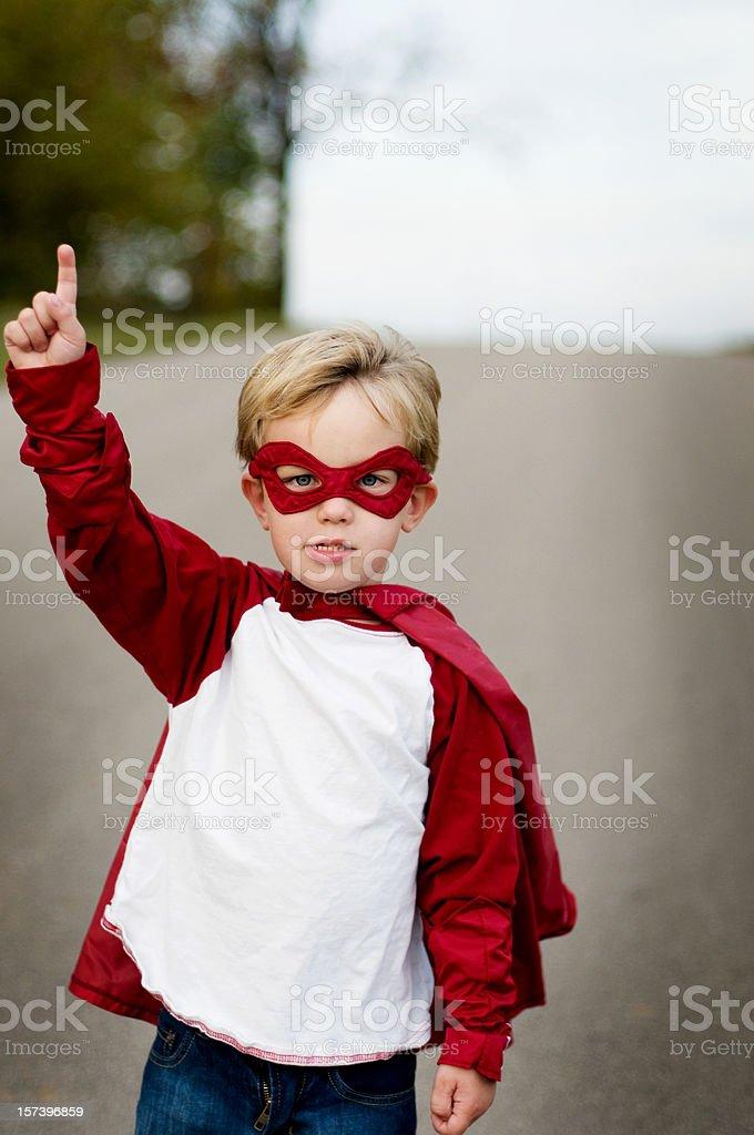 Pointing superhero royalty-free stock photo