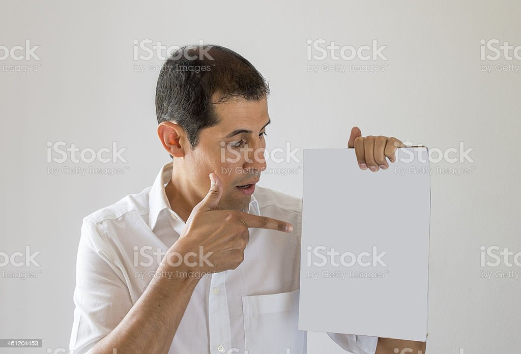 pointing to the cover of a magazine royalty-free stock photo