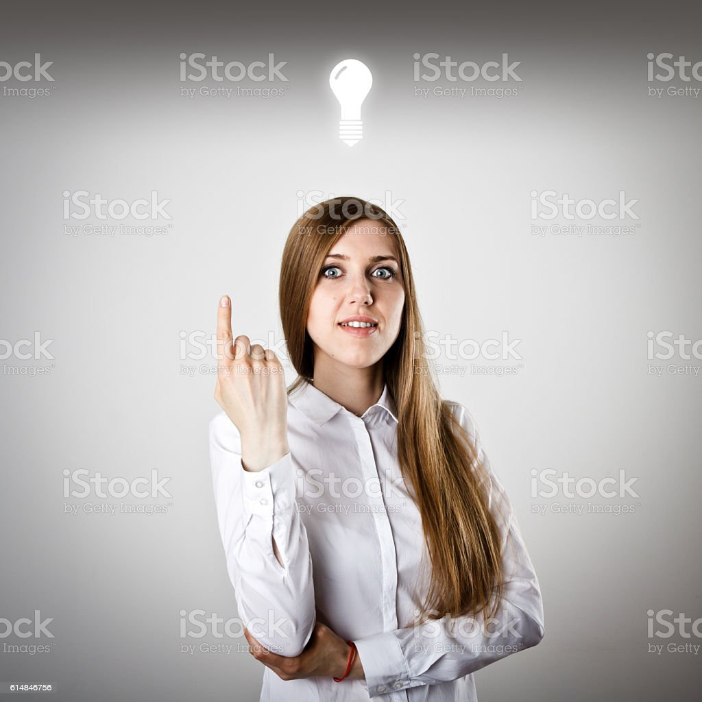 Pointing. Woman in white and IDEA stock photo