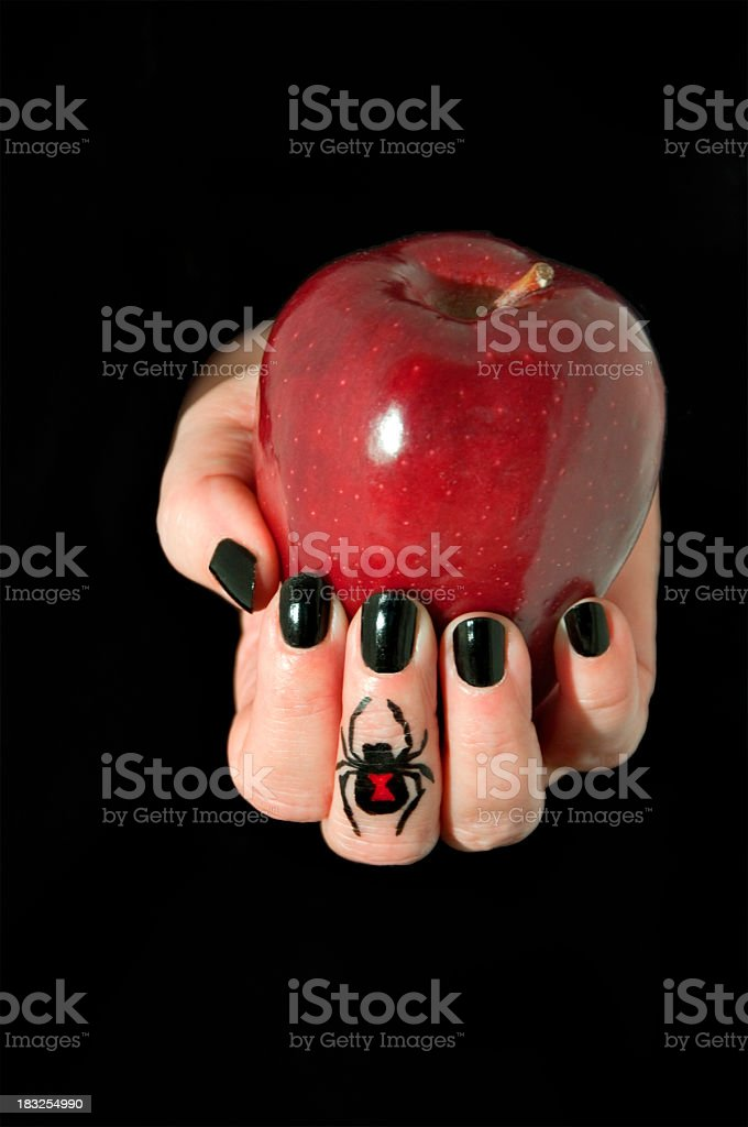poison apple in hand royalty-free stock photo
