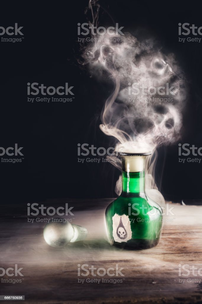 poison bottle on a table stock photo
