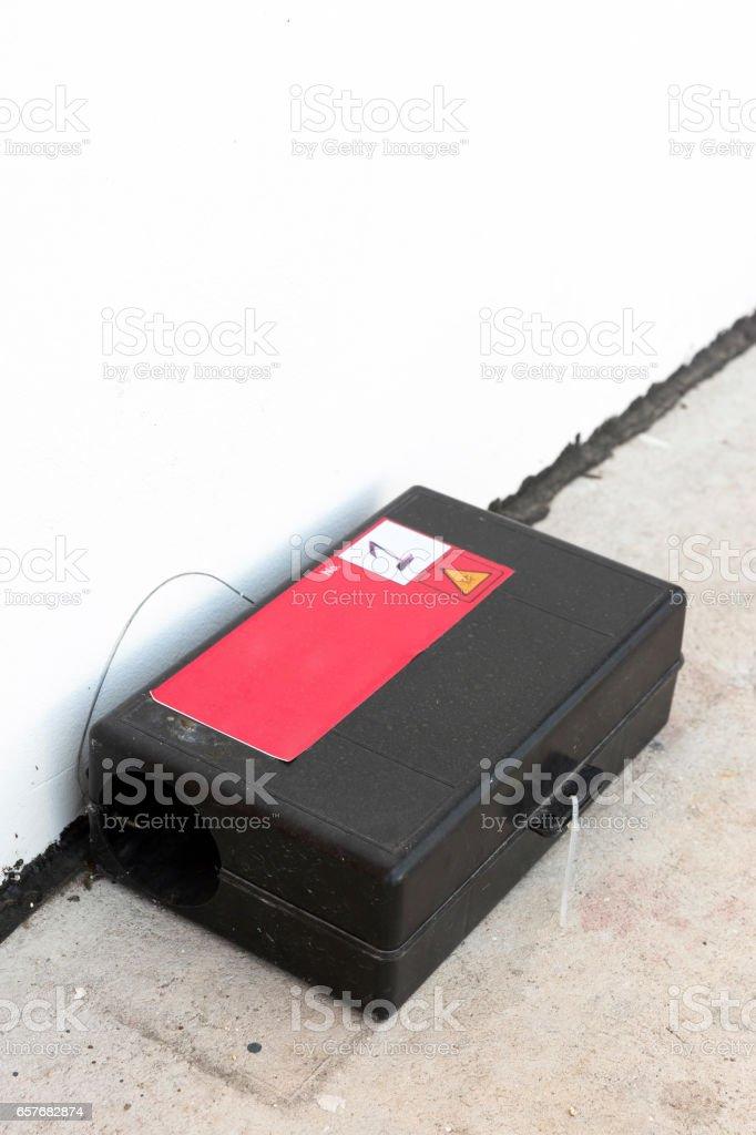 Poison rat trap box on floor near wall stock photo