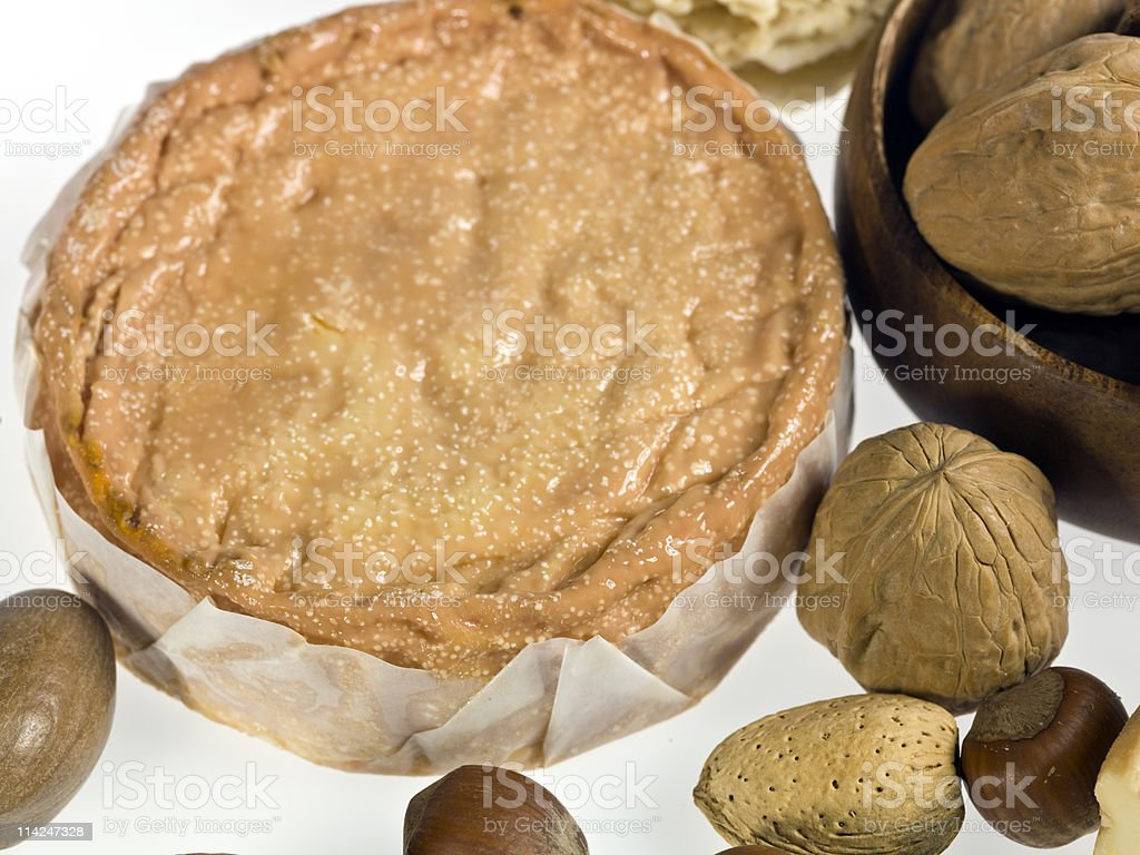 ?poisses de Bourgogne French cheese with dried fruits stock photo