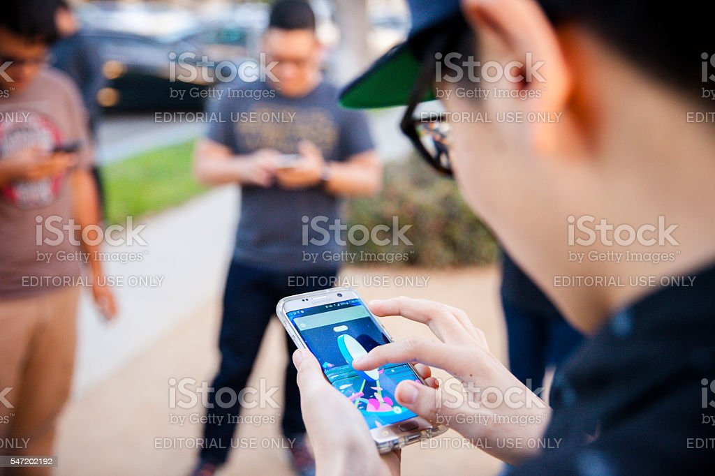 Pokemon Go App Being Played on iPhone stock photo