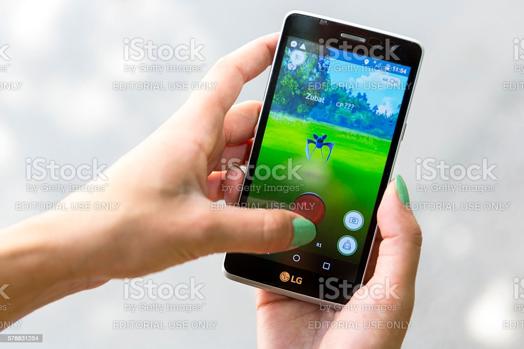 Pokemon Go game in a hand. Zubat stock photo