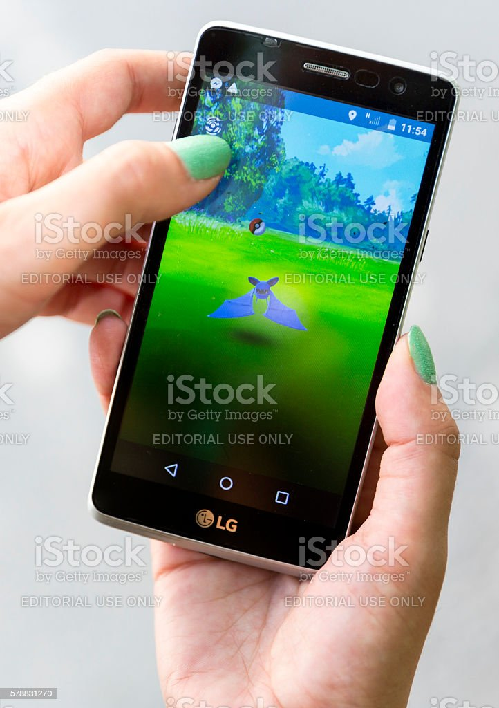 Pokemon Go game in a hand. Zubat stock photo